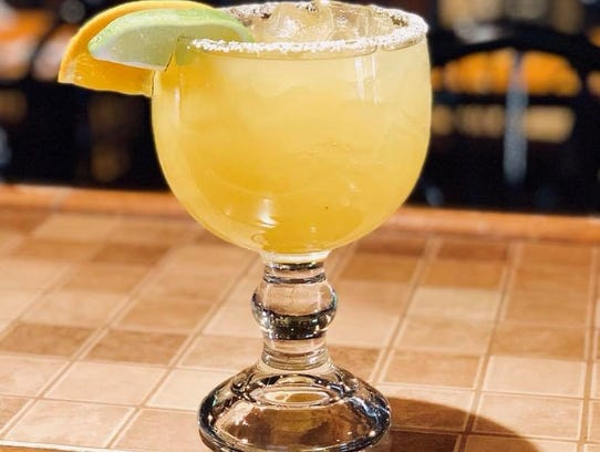 An 18-ounce original lime margarita on the rocks with