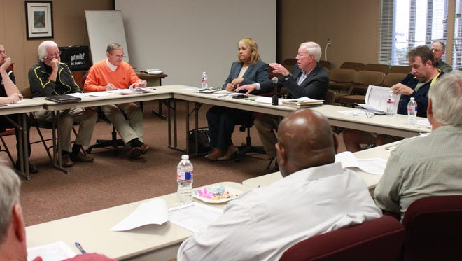 Members of the Madison County Commission and the Jackson-Madison County School Board meet for the education vision committee Tuesday.