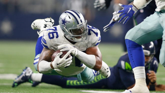 Dallas Cowboys defensive end Greg Hardy (76) returns an interception in the third quarter against the Seattle Seahawks at AT&T Stadium.