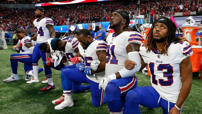 Bills players take a knee during the national anthem.