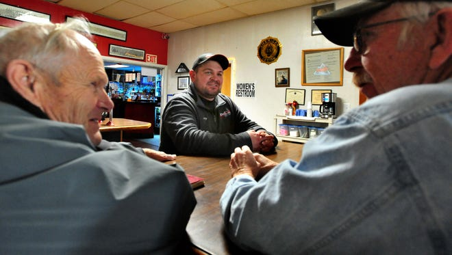 Jerry Collins, center, post commander of the American Legion in Choteau, talks with Les Arensmeyer, left, and Bruce Callender in November of 2017 about membership and fundraising issues in a small town post like theirs.
