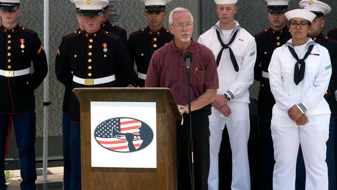 """Volunteer Mike Horgan reads his list of names Sunday, May 20, 2018 during """"Reading of the Names"""" at The Wall South. Volunteers will read all 58, 318 names of Servicemen and women which will take place from May 20 through Memorial Day on May 27."""