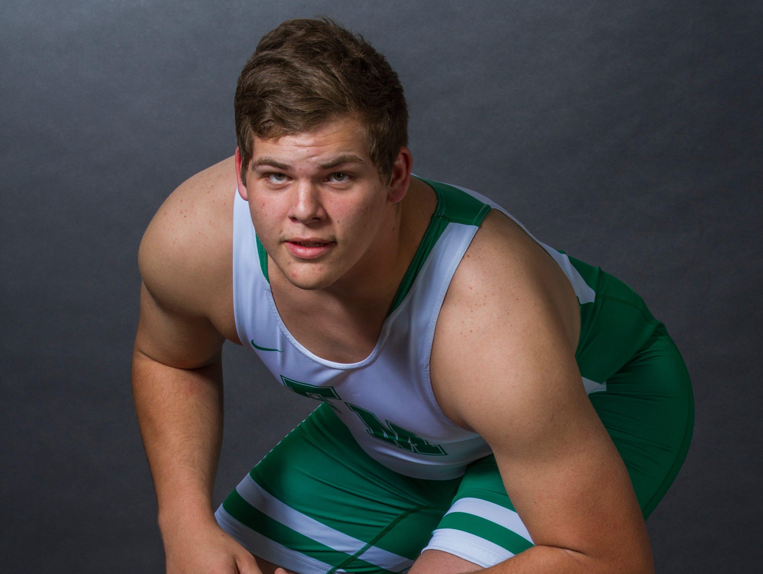 Mike Delago, 18, is a senior wrestler at Fort Myers High School.