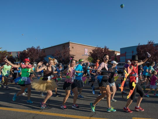 Runners in costume start the 49th Annual Journal Jog