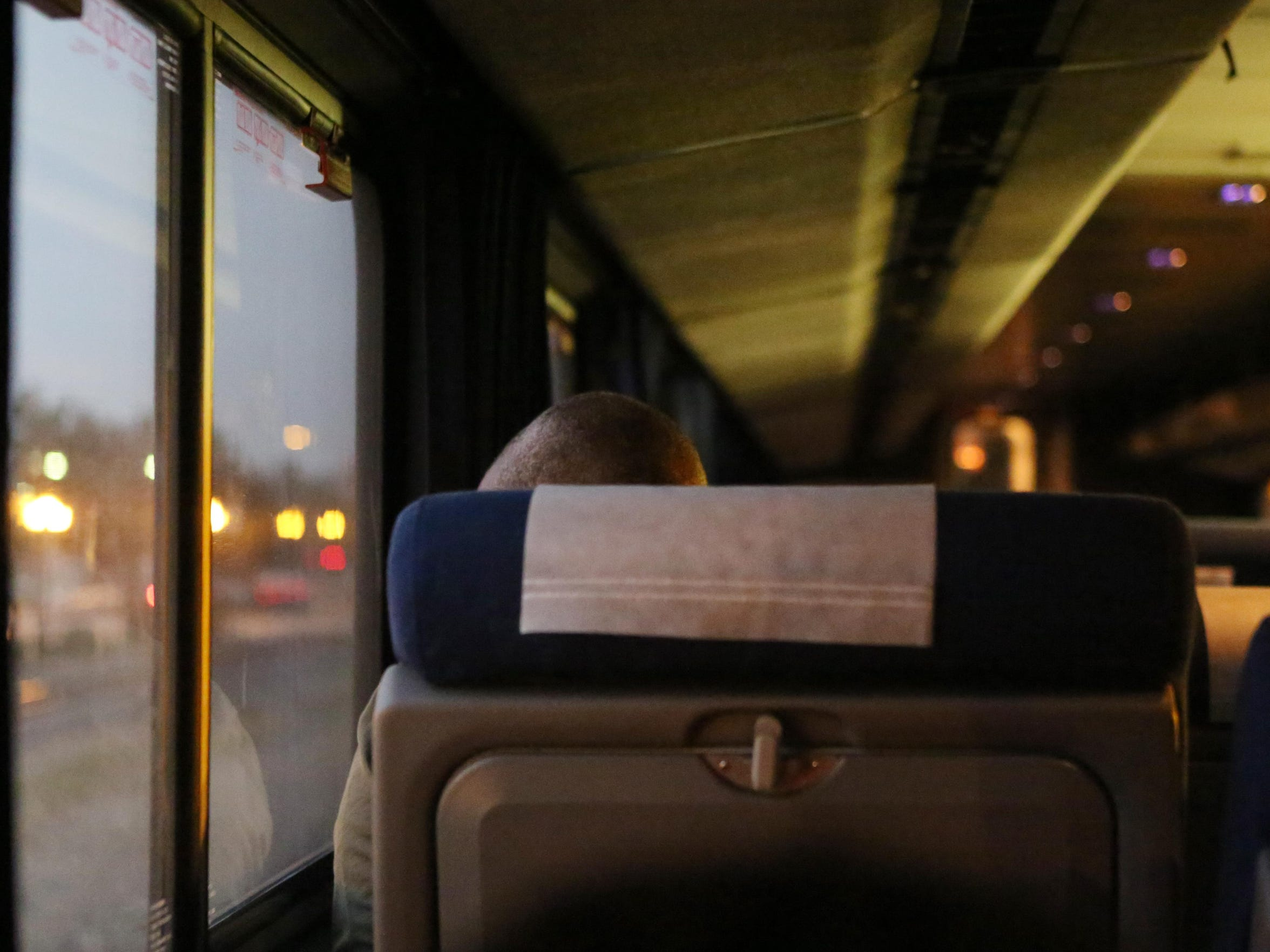 A passenger looks out the window of the westbound train