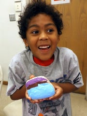 This child shows off his painted rock during the Alamogordo Public Library's painting party.
