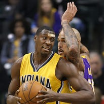 Indiana Pacers center Ian Mahinmi (28) runs into the elbow of Los Angeles Lakers guard Louis Williams (23) in the first half of their game.  Mahinmi left the game to get medical attention. The Indiana Pacers host the Los Angeles Lakers Monday, Feb8, 2016, evening at Bankers Life Fieldhouse.