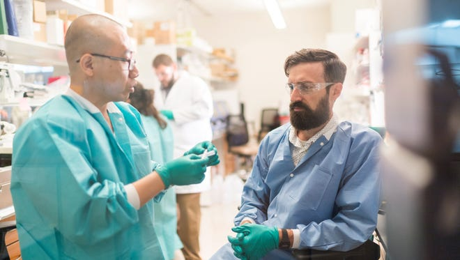 Regenerative biology researchers Jue Zhang (left) and Matt Brown of the Madison-based Morgridge Institute work in the lab to develop arterial tissue.