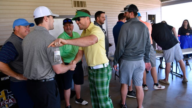 Denver Broncos starting quarterback Case Keenum greets golfers Friday at Diamondback Golf Club during the Big Country Fellowship of Christian Athletes Golf Tournament. Keenum, an Abilene native, played quarterback for Wylie High School from 2003-05, winning the state championship in 2004.