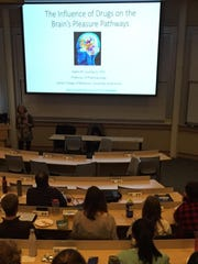 Karen Lounsbury, UVM professor of pharmacology, gives the keynote speech at the Vermont Brain Bee.
