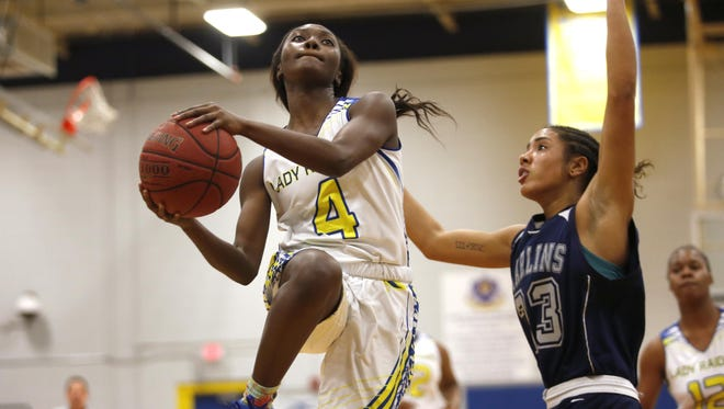 Rickards senior Katelyn Marshall drives past PC Arnold's Jazlin Jones during their Region 1-5A quarterfinal game at Rickards on Thursday. The Raiders won 62-26 and Marshall had nine points and seven steals.