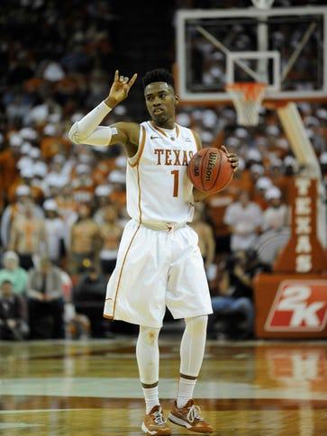 Texas Longhorns guard Isaiah Taylor (1) reacts against