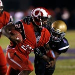 Manual's Trae Gordon (#22) fights for some touch yards against Male's Demetrius Holt Oct. 24, 2014