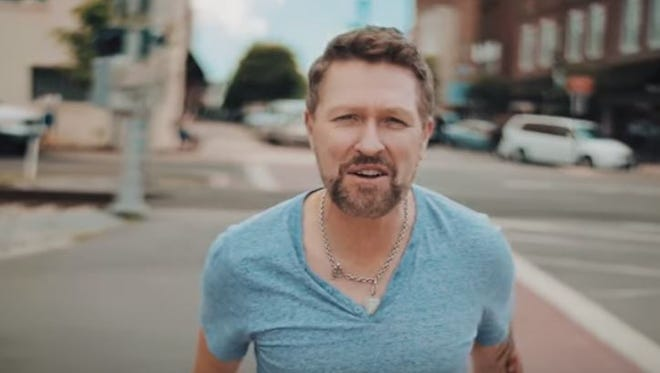 "Screenshot of music video of Craig Morgan singing his new single, ""I'll Be Home Soon,"" on Main Street in Dickson County."
