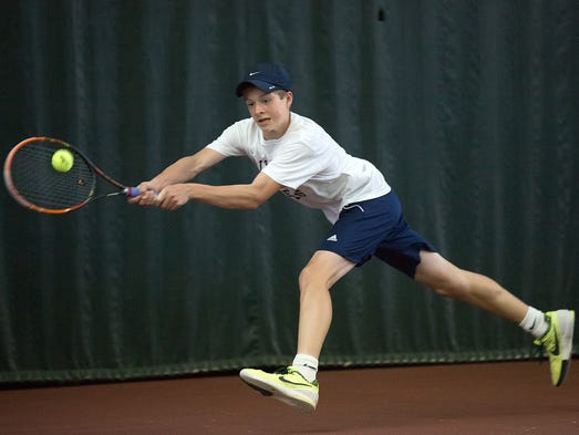 Dallastown's Holden Koons returns a shot from Cumberland