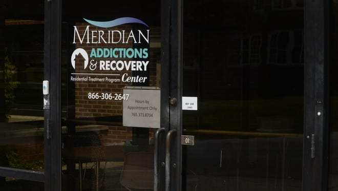 Behind the entry to Meridian Addictions and Recovery Center is a sun room with tables for art lessons and puzzles.