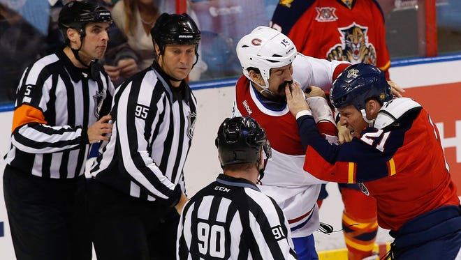 Montreal Canadiens right wing George Parros (15) fights with Florida Panthers right wing Krys Barch last season. Neither has a job this season.