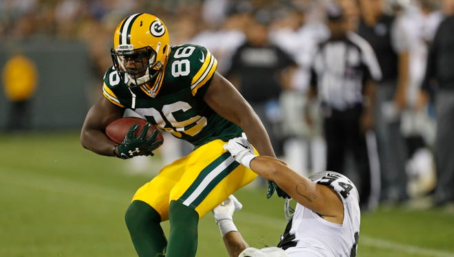 Green Bay Packers tight end Kennard Backman is tackled by Oakland Raiders defensive end Greg Townsend during an NFL preseason game in Green Bay, Wis., Thursday, Aug. 18, 2016.