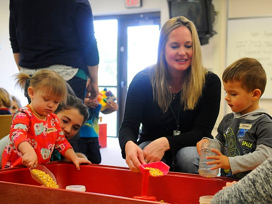 Paraprofessional substitute Kimberly Stout plays with kids in the early childhood class on Oct. 9, at Hillside School.