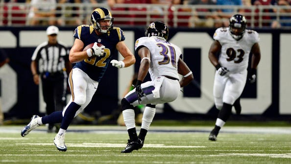 Aug 29, 2013; St. Louis, MO, USA; St. Louis Rams tight end Mike McNeill (82) carries the ball as Baltimore Ravens defensive back Omar Brown (31) defends during the first half at Edward Jones Dome. Mandatory Credit: Jeff Curry-USA TODAY Sports