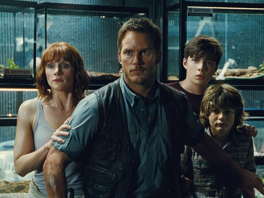Bryce Dallas Howard, from left, as Claire, Chris Pratt as Owen, Nick Robinson as Zach, and Ty Simpkins as Gray, face a dangerous creature in Jurassic World. Universal Pictures/Amblin Entertainment via AP