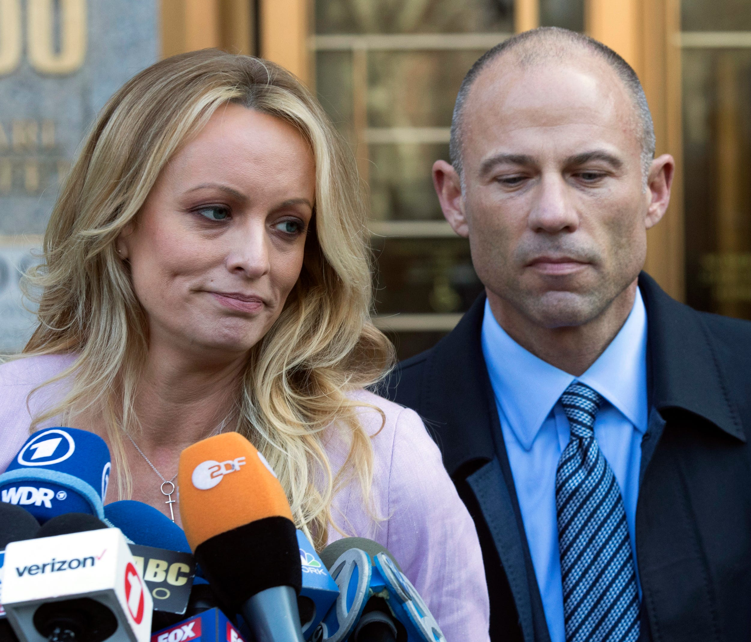 In this April 16, 2018 file photo, adult film actress Stormy Daniels, left, stands with her lawyer Michael Avenatti as she speaks outside federal court, in New York.