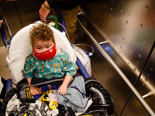 Will Kohn rides an elevator to the 12th floor of the Stead Family Children's Hospital to watch the fans at Kinnick Stadium wave to the children in the hospital.