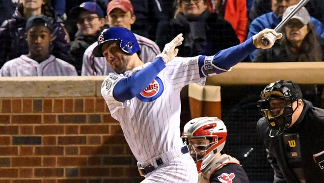 Kris Bryant hits a solo home run in the fourth inning.