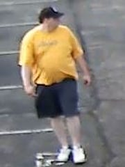 An unidentified male seen on surveillance video placed