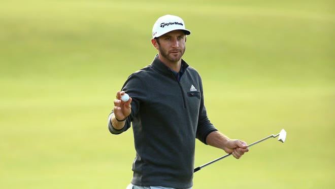 Dustin Johnson of the United States acknowledges the crowd on the 18th green during the second round of the 144th Open Championship at The Old Course on July 18, 2015 in St Andrews, Scotland.