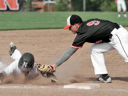 Brightons Carson Hopman tags the rrunner out before he could make it to 3rd[.jpg