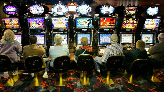 People gamble at the Mohegan Sun Pocono Downs in Wilkes-Barre, Pa..
