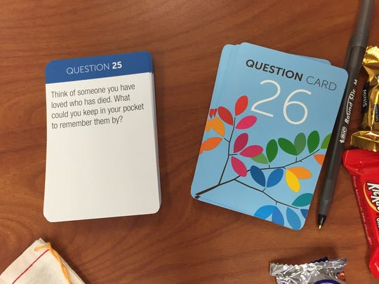 """Each card in the """"My Gift of Grace"""" game offers a question or discussion topic having to do with end of life decisions. Three developers of the game recently visited Richmond to do workshops with Reid Hospital physicians and staff and Ivy Tech Community College nursing students."""