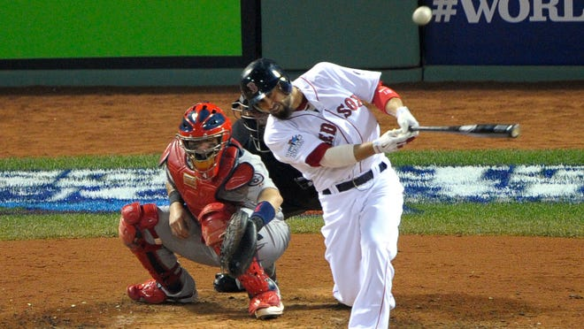 Shane Victorino hits a three-run double against in the third inning at Fenway Park.