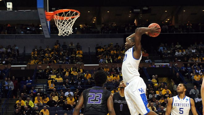 Kentucky forward Julius Randle dunks in front of Kansas State's Nigel Johnson (23) in the first half last week in St. Louis.