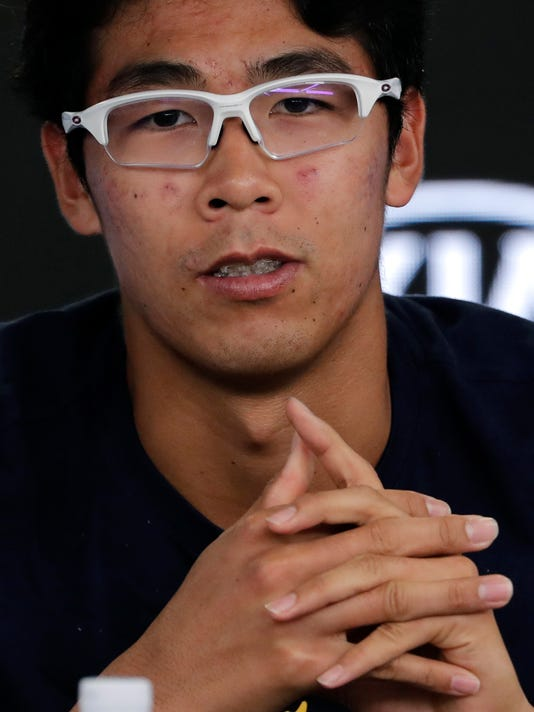 South Korea's Hyeon Chung answers questions at a press conference following his retirement from his semifinal against Switzerland's Roger Federer at the Australian Open tennis championships in Melbourne, Australia, Friday, Jan. 26, 2018. (AP Photo/Vincent Thian)