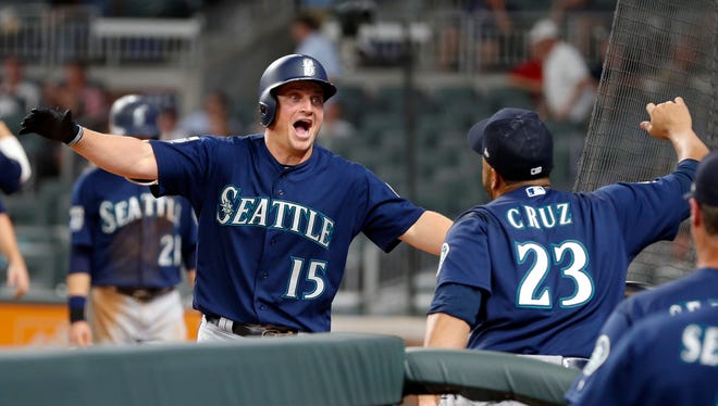 Seattle Mariners' Kyle Seager (15) celebrates with Nelson Cruz (23) after hitting a three-run home run in the eighth inning of Wednesday's game in Atlanta.