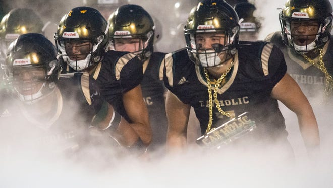 Knoxville Catholic emerge onto the field for the game against Campbell County on Friday, November 3, 2017.