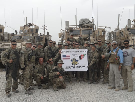 Soldiers at Bagram Air Base in Afghanistan salute Operation Yellow Ribbon of South Jersey for sending them care packages from home.