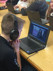 Weylin Johnson watches a tutorial video during the