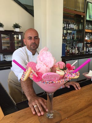 """Peter James Smith, executive chef at JW Marriott Desert Springs Resort in Palm Desert looks at the """"Pink Flamingo"""" shake he just made. (June 2018)"""