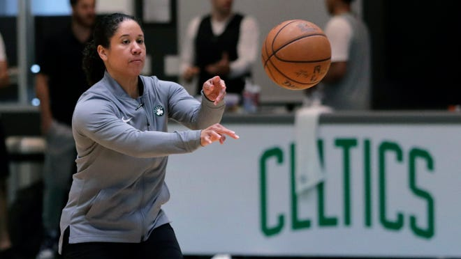 FILE - In this July 1, 2019, file photo, Boston Celtics assistant coach Kara Lawson passes the ball at the team's training facility in Boston. A person familiar with the situation says Duke is in talks with Boston Celtics assistant coach and former WNBA All-Star Lawson to lead the Blue Devils women's basketball program. The person spoke to The Associated Press on condition of anonymity Friday, July 10, 2020, because the school has not commented publicly on its search.