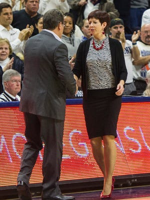 Dec 5, 2015; Storrs, CT, USA; Notre Dame Fighting Irish head coach Muffet McGraw congratulates Connecticut Huskies head coach Geno Auriemma on winning the game at Gampel Pavilion.  Connecticut won 91-81. Mandatory Credit: Gregory J. Fisher-USA TODAY Sports