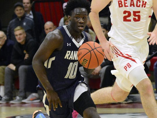 Ranney's Ahmadu Sarnor (10) dribbles against Point Beach's Jake Lorenzo (25) during the opening game for both teams last  Friday.