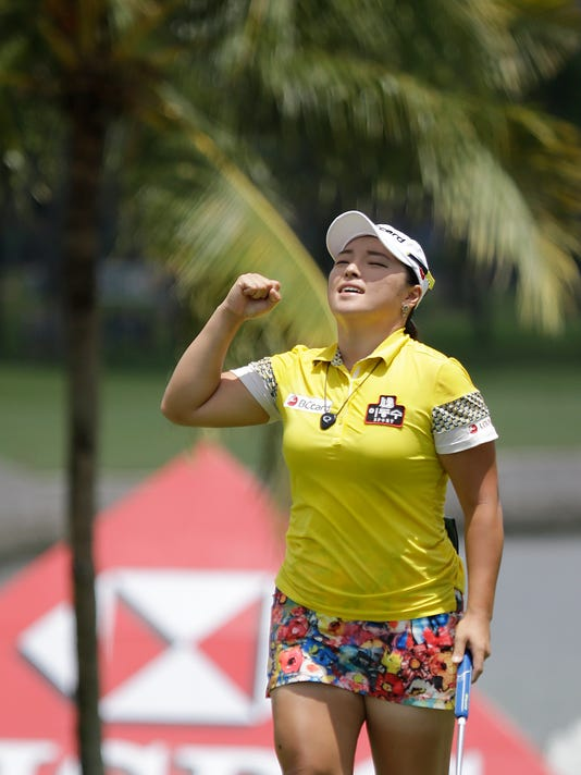 Jang Ha Na of South Korea celebrates after sinking a shot on the 9th green during the final round of the HSBC Women's Champions Golf tournament on Sunday, March 6, 2016, in Singapore. (AP Photo/Wong Maye-E)