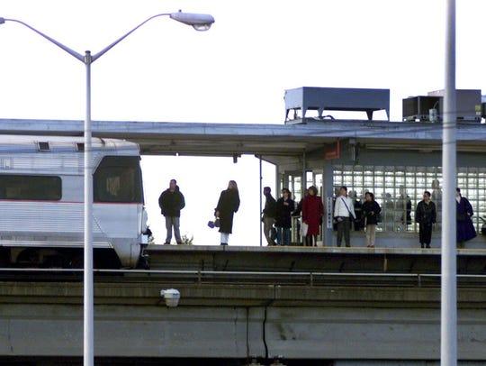 - Commuters wait for a PATCO Hi-Speedline train on