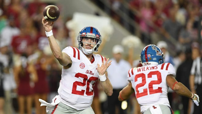 Shea Patterson passes against Alabama in 2017.