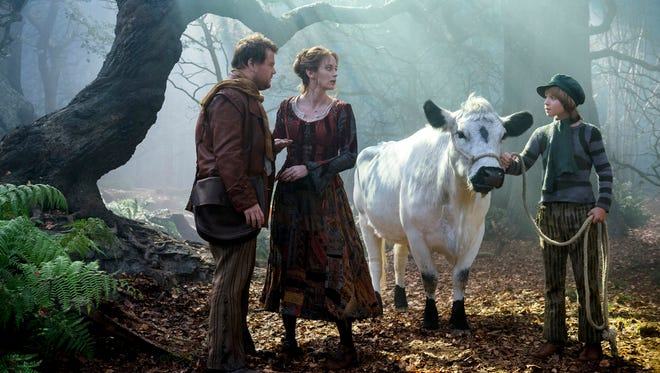 The Baker (James Corden) and his wife (Emily Blunt) meet Jack (Daniel Huttlestone) and his cow, Milky Way, in 'Into the Woods.'