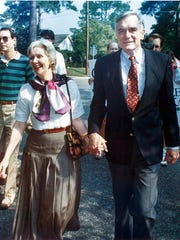 In 1990, Rhea Chiles walks hand in hand with her husband, Lawton Chiles, during his campaign for governor.