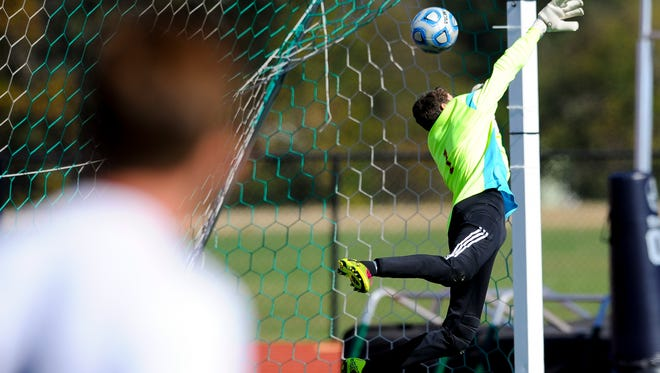 Mater Dei's Lucas Daunhauer (1) fails to block a goal during a Class A semistate game against the Providence  at Bundrant Stadium in Evansville, Saturday, Oct. 22, 2016. Providence beat Mater Dei 4-0.